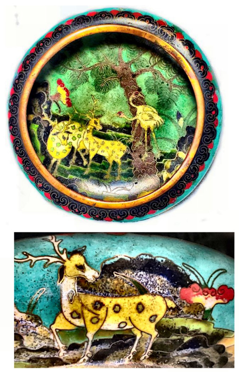 Objects made of cloisonné are not limited to decorative pieces. This beautifully crafted Chinese cloisonné bowl is a 19th century brush pot, used for washing calligraphy and artist's brushes. Not only is this beautiful piece utilitarian, it is decorated with deeply symbolic images. The pot is decorated both on the inside and outside with deer (longevity and wealth), cranes (longevity and peace), butterflies (immortality and conjugal bliss) and pine trees (longevity, solitude, steadfastness and marital bliss) the predominant color, green, is symbolic for harmony, wealth and growth. The image at the bottom is a detail from around the outside of the pot. The detail the artist was able to achieve is so fine it appears like a painting rather than brass partitions filled with enamel.