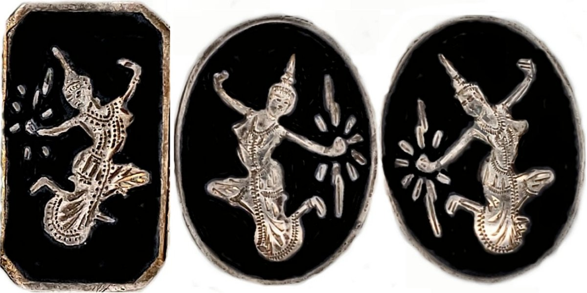 """This image shows a pair of earrings and a panel from a bracelet marked """"Siam"""" - pieces adorned with niello are known as """"nielli."""" Niello made in Siam is unique in that niello is absent in the engraved areas, contrary to most nielli. In Siam, the pieces are re-engraved after heating, thus exposing the silver beneath. Gold is also used as the background material, although silver is the preferred metal for the jewelry of """"Siam."""""""