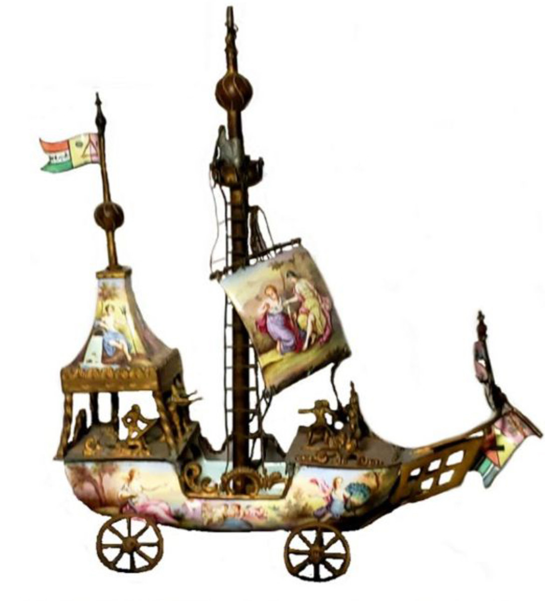 This nineteenth century, hand-painted, enamel, Austrian, silver and gilt ship on wheels was made strictly for ornamentation.