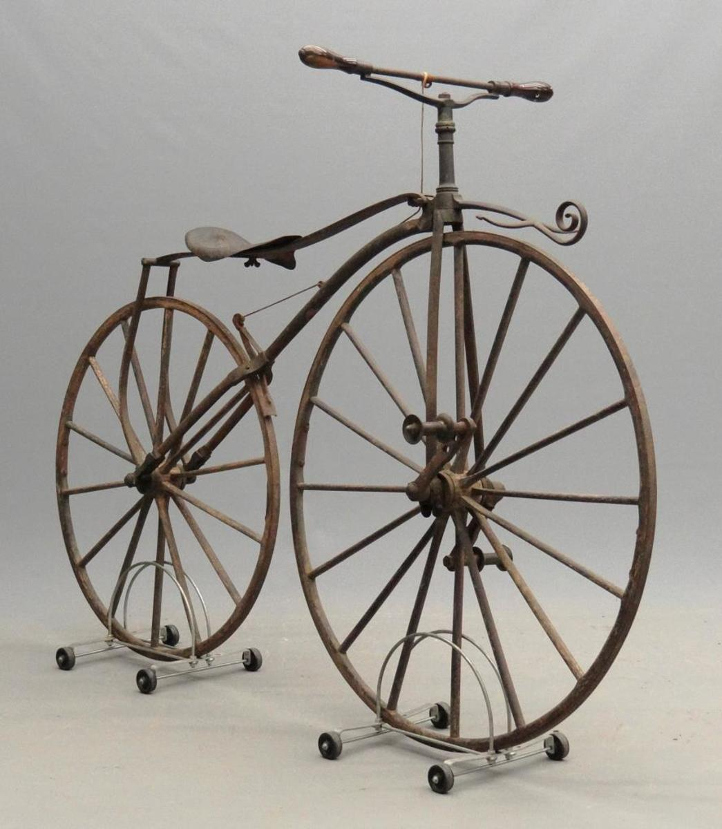 "A rare circa 1869 Calvin Witty N.Y.C. boneshaker, which retains the name plate (Calvin Witty/Maker/Pat. Nov. 20, 1866/638 Broadway NY"") and matching pedals, brake, rosewood grips and original wheels; $14,040."