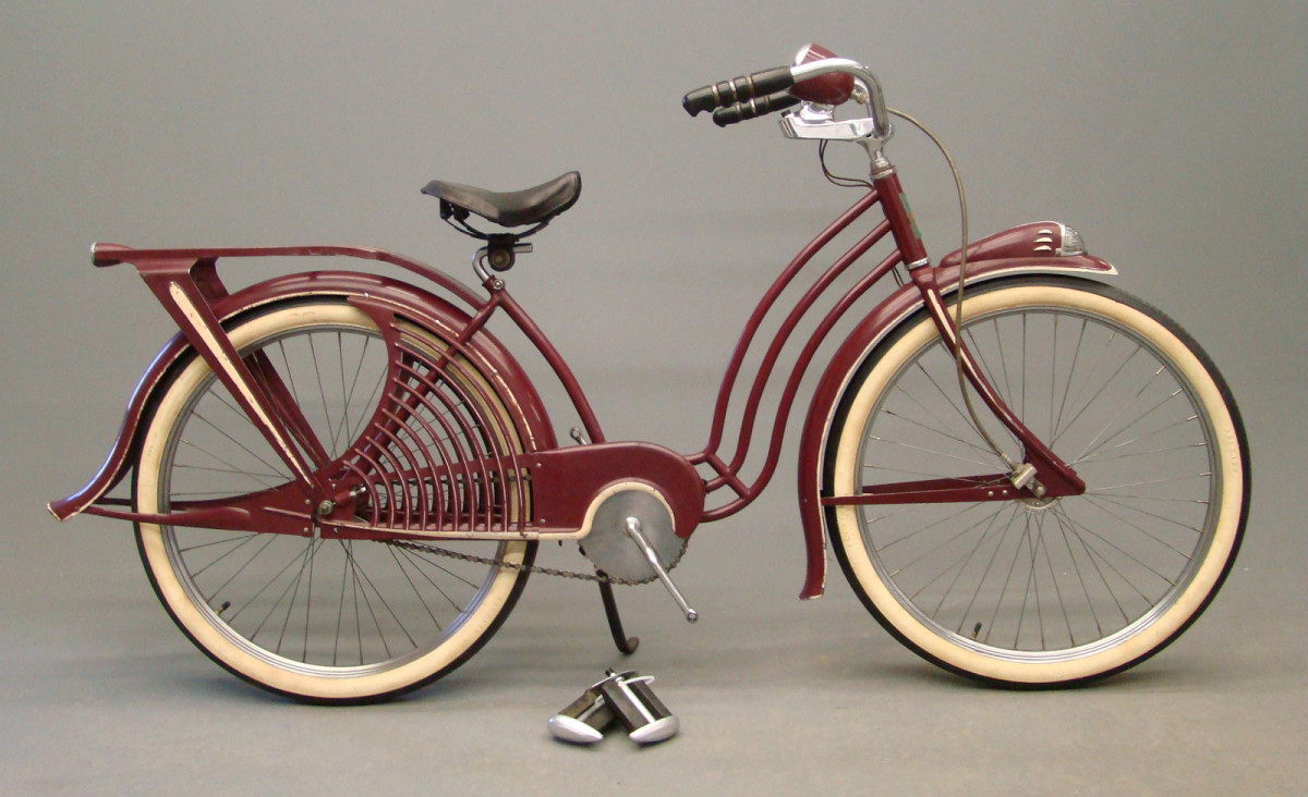 A 1936 Elgin Skylark girl's bicycle, sister to the Elgin Bluebird. Correct Allstate white side tires and rare Milsco leaf sprung girl's saddle make this a desirable addition to any balloon-tire bicycle collection; $3,500.