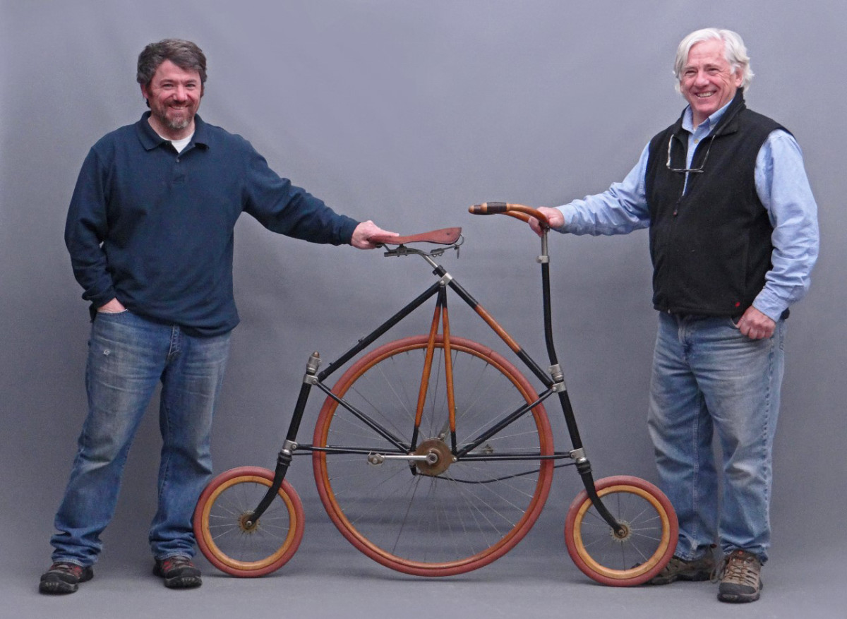 Mike Fallon, right, and his son, Seth, with the unique and rare (possibly only one in the world) high wheel with leading and trailing dual steering. Mike said that many years ago when they were dispersing the Pope Manufacturing Co. reference library, he saw this machine in one of the bound volumes, and remembers it as being created in a mid-west college for hearing impaired students. From the David Metz Museum; $42,120.