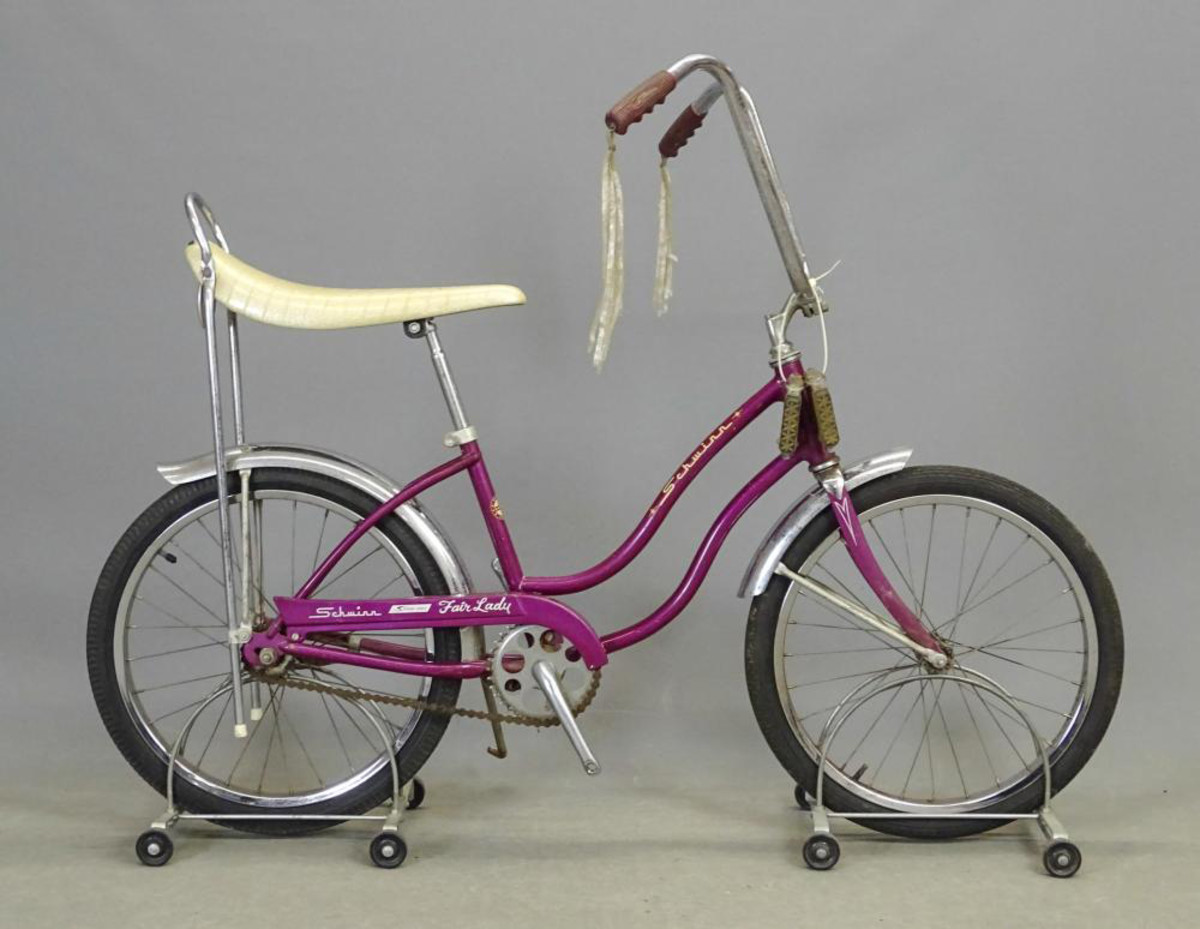 A Schwinn Stingray Fair-Lady with original purple paint and decals, seat, tire and grips, $70.