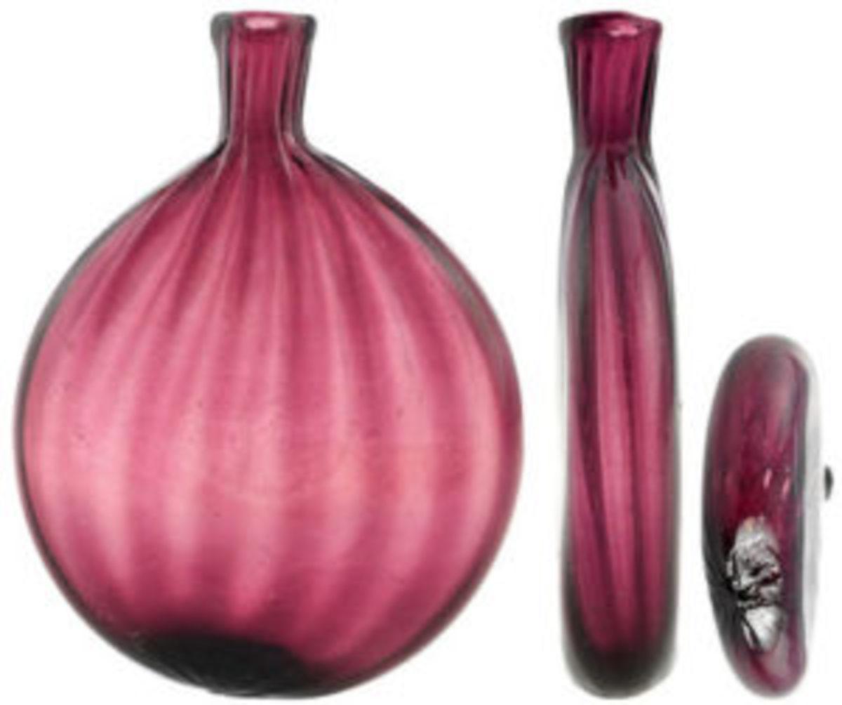 "Pattern-molded pocket flask, 6-1/4"" h, medium pink amethyst, Germany, 1795-1820, $400-$600."