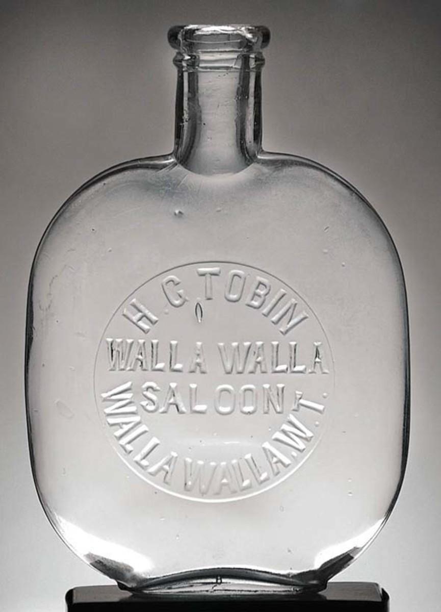 Western Pumpkin Seed Flask, Pint, Clear, H.T. Tobin/Walla Walla Saloon/Walla Walla W.T. 1870, $4,840 (July 2017).