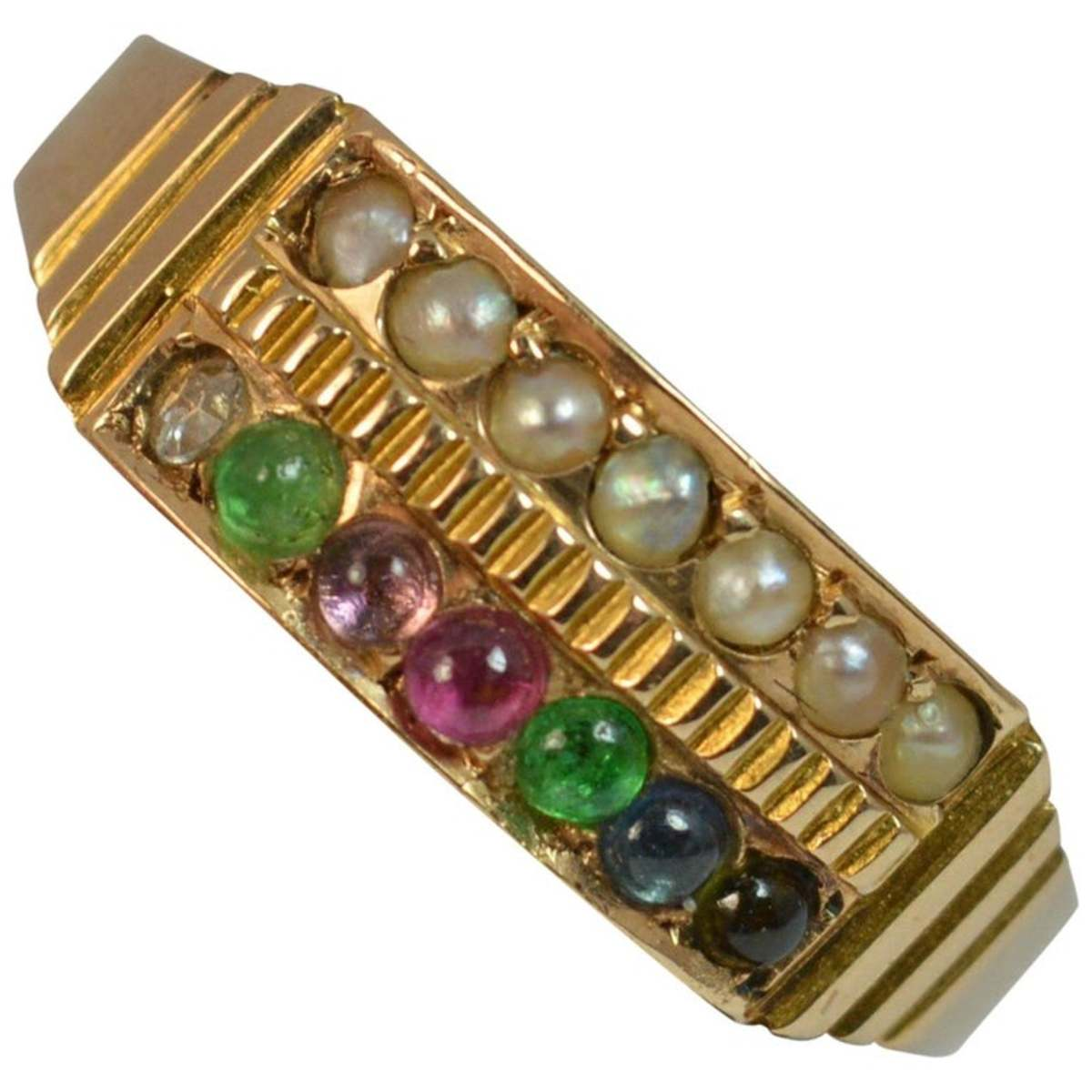 "Victorian period ""Dearest"" ring, set with diamond, emerald, amethyst paste, ruby, emerald, sapphire and topaz on one half and seed pearls on the other; $957."