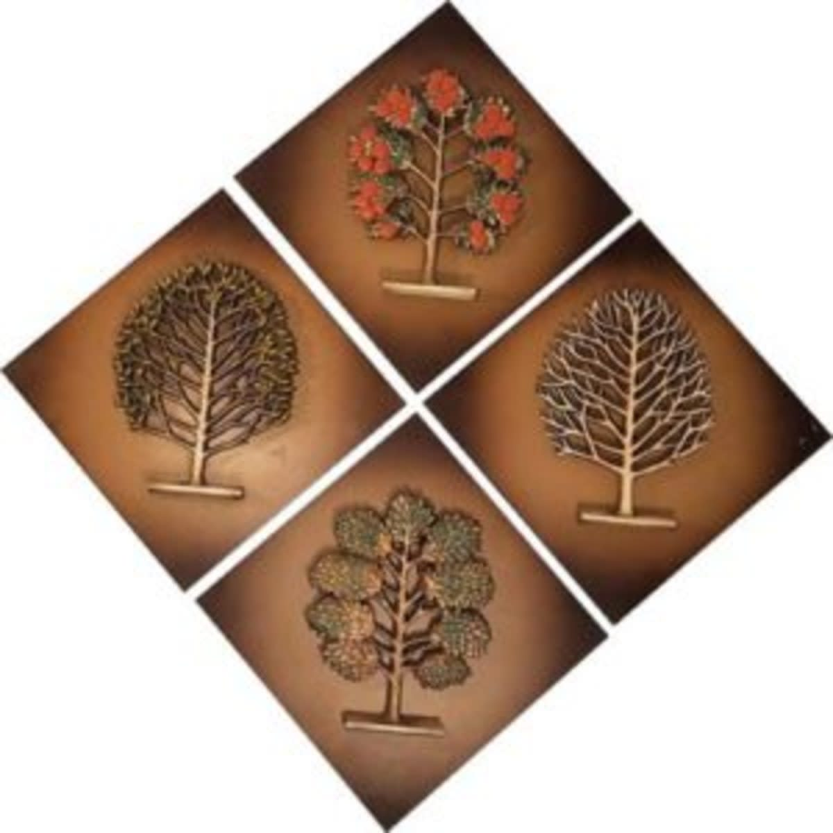 This set of four mid-century Syroco® plaques depict the four seasons. Each diamond-shaped plaque features a tree that represents one of the seasons.