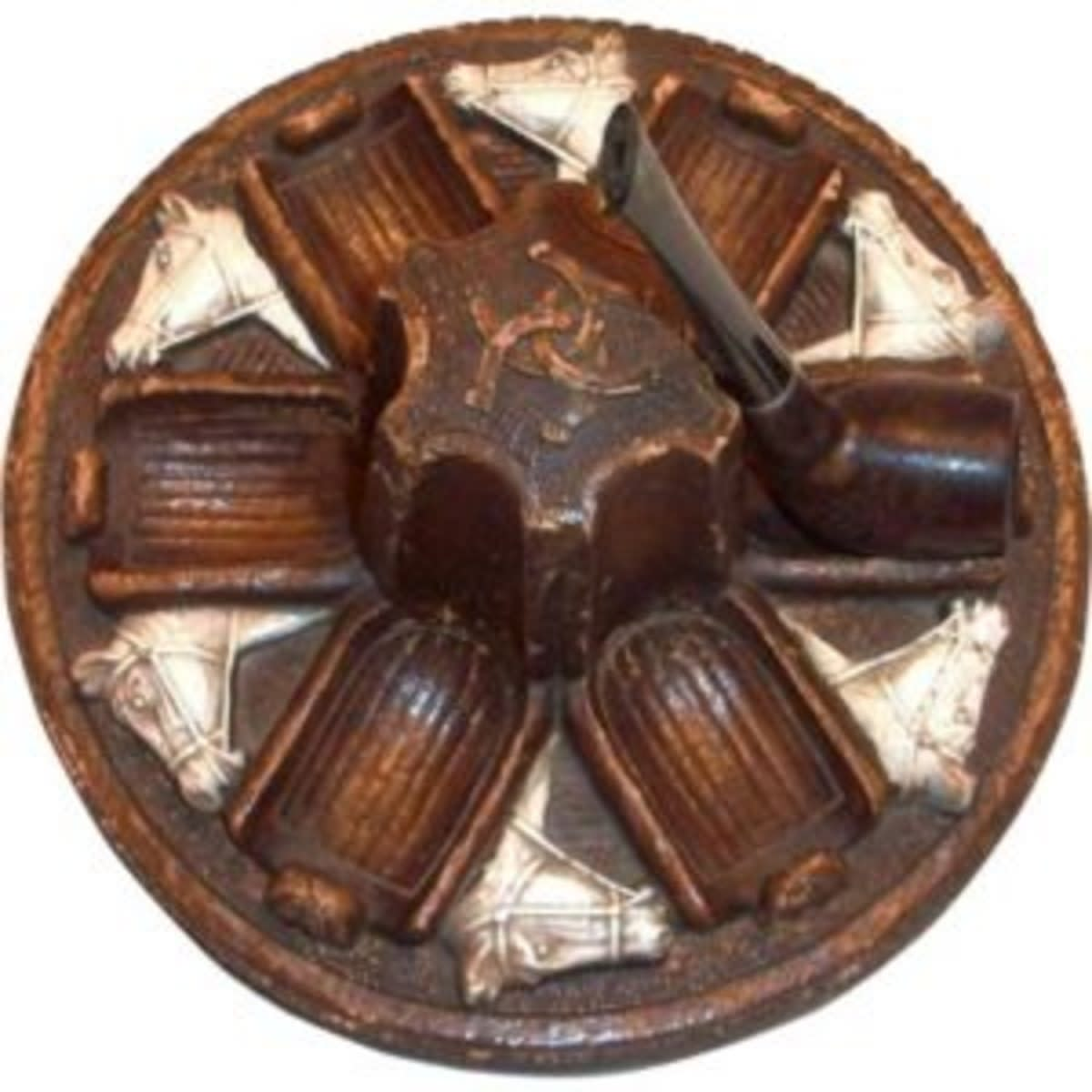 This vintage Syroco pipe holder holds up to six pipes and sold for $75.