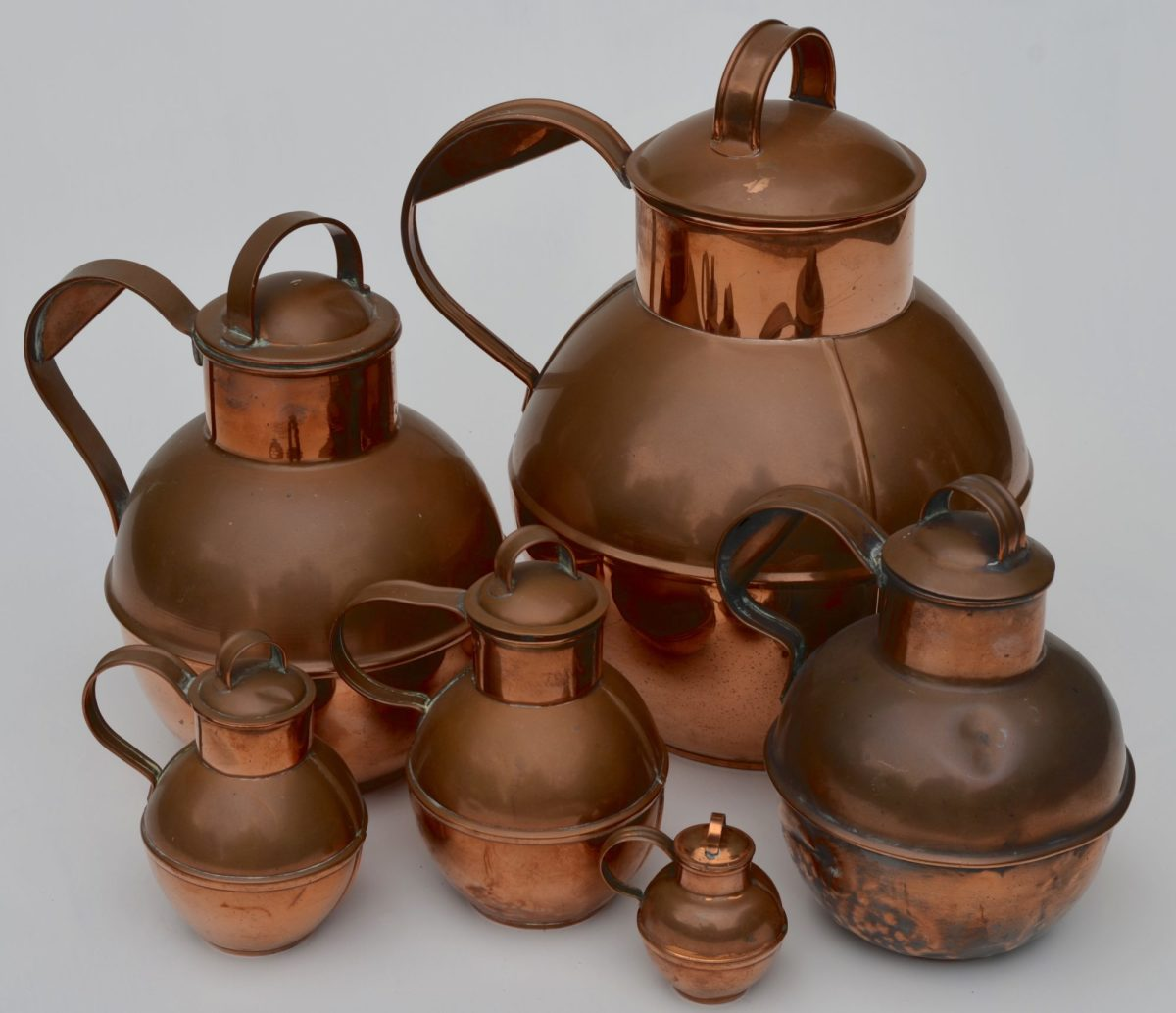 Guernsey milk pots. Guernsey is one of the Channel Islands just off the northern coast of France. These containers have been made in this same design for over 1,000 years. The examples here range in volume from one gallon to an eighth of a pint.