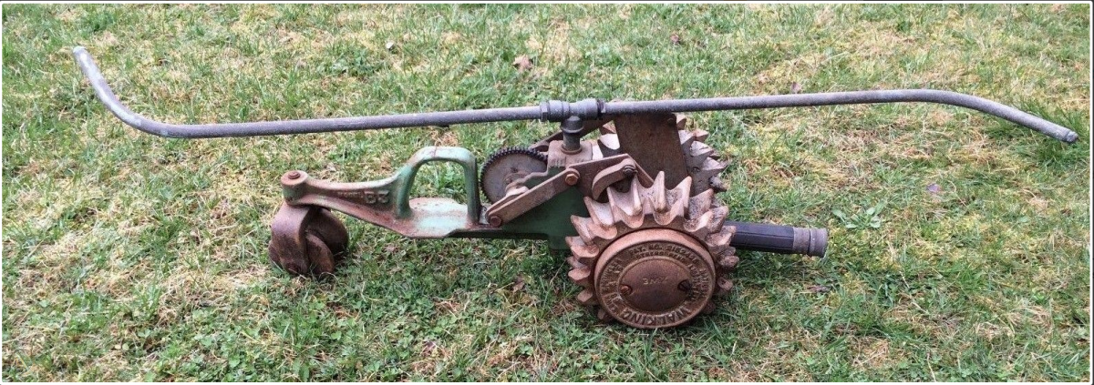 A cast iron National Walking Lawn Sprinkler Tractor B3 Model.