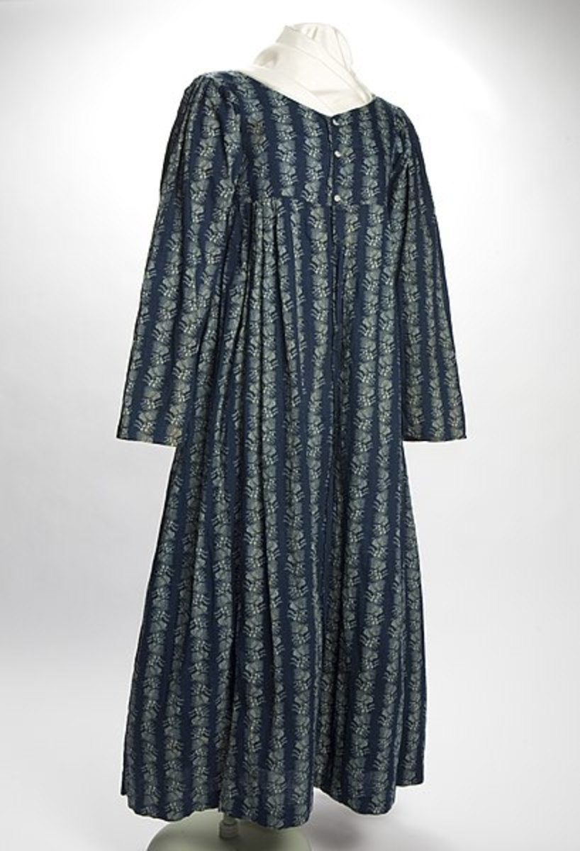 The blue cotton calico Mother Hubbard dress of Elizabeth Hinterleiter Keesacker, a Virginia native who moved to St. Louis in the early 1800s. The Mother Hubbard was acceptable as a house dress, but considered indecent to wear in public because it was worn with little or no corseting.