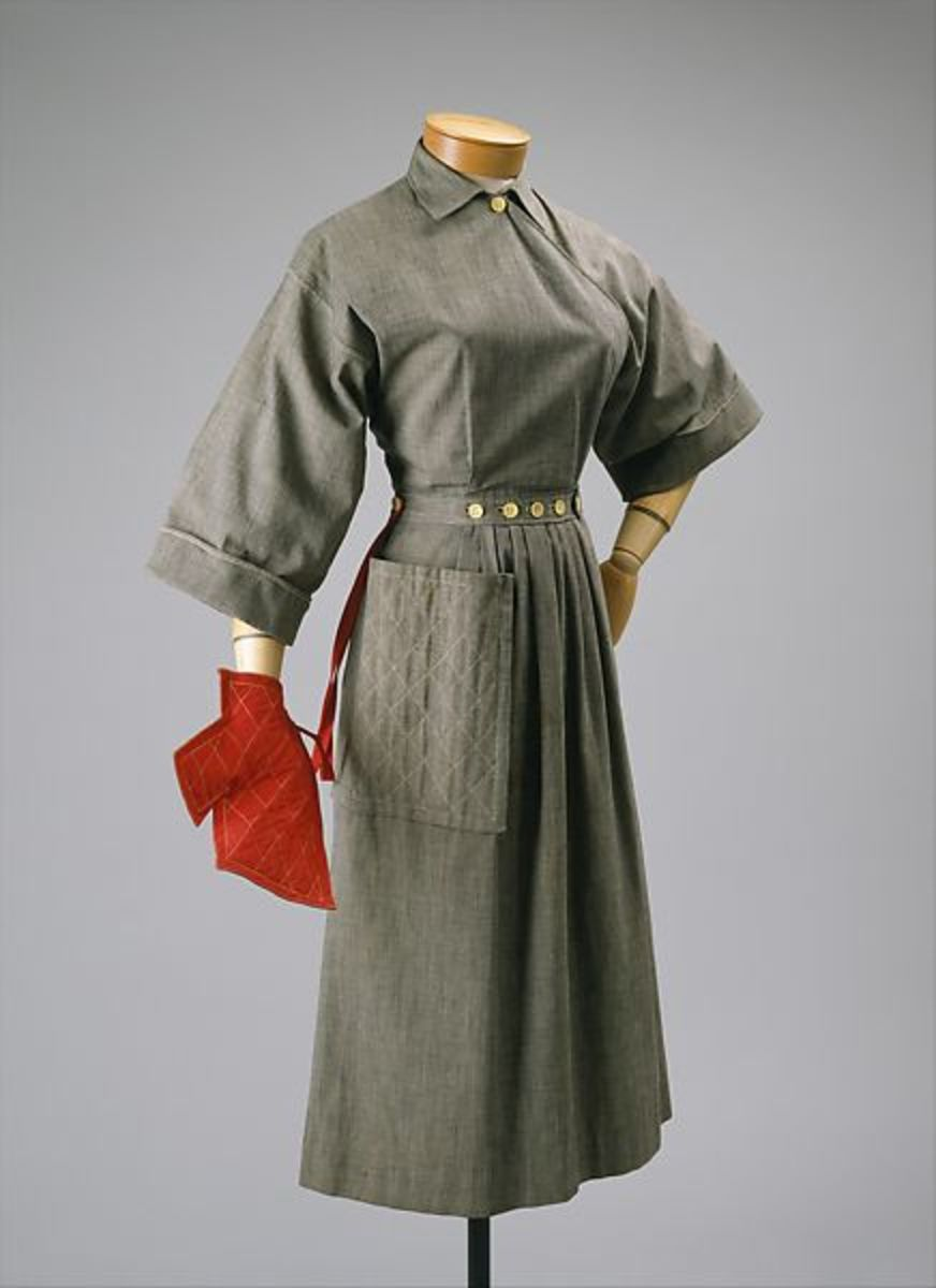 "Claire McCardell's ""Pop-over"" dress with oven mitt, 1942. In utility achieved with ingenuity, McCardell found a synergy: the modern woman could do the cooking while looking chic. The dress was priced at $6.95 and thousands were sold."