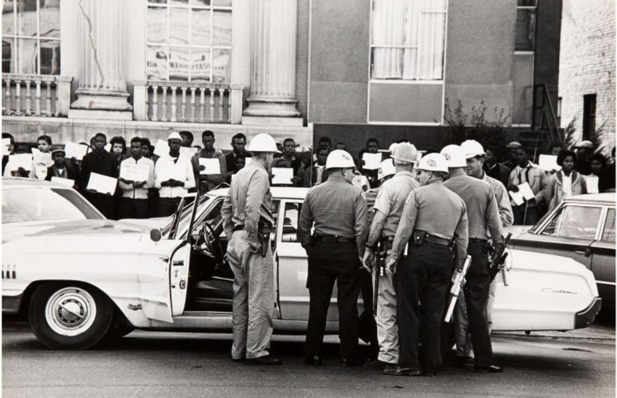 """Police in Selma, Alabama are Watching Negroes who Demonstrate for the Right to Vote,"" 1965. Estimate: $1,500-$2,500."