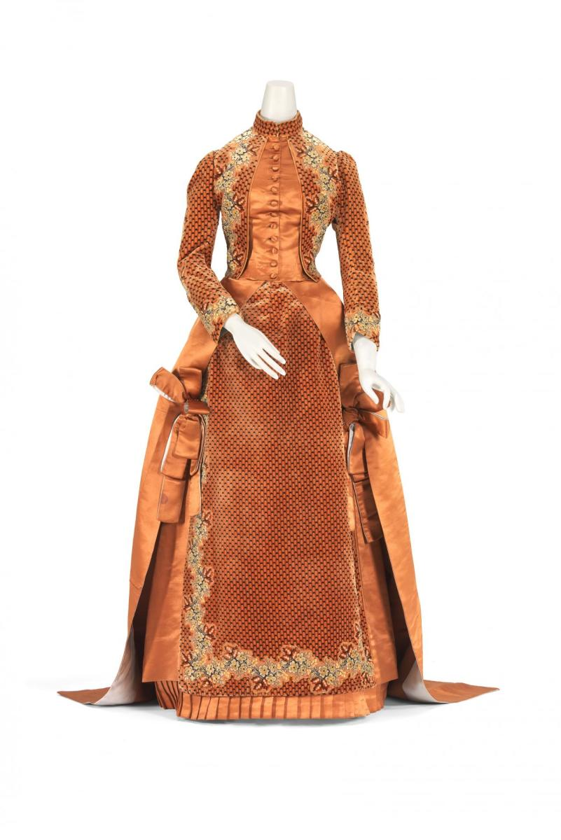 An afternoon dress, c. 1890, by Charles Frederick Worth, silk, satin and cut velvet.