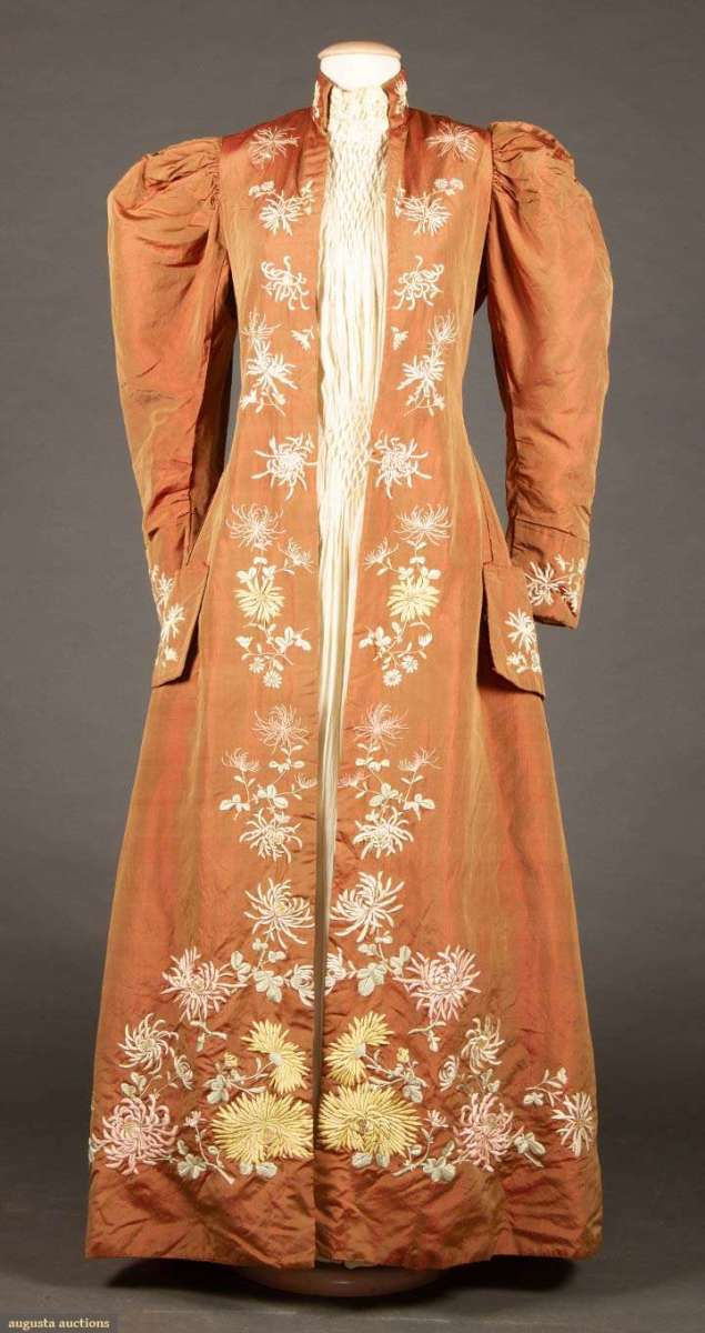 A copper changeante silk taffeta morning robe, c, 1895, with hand-embroidered yellow, pink and white chrysanthemums, Japan. This sold at auction for $518.