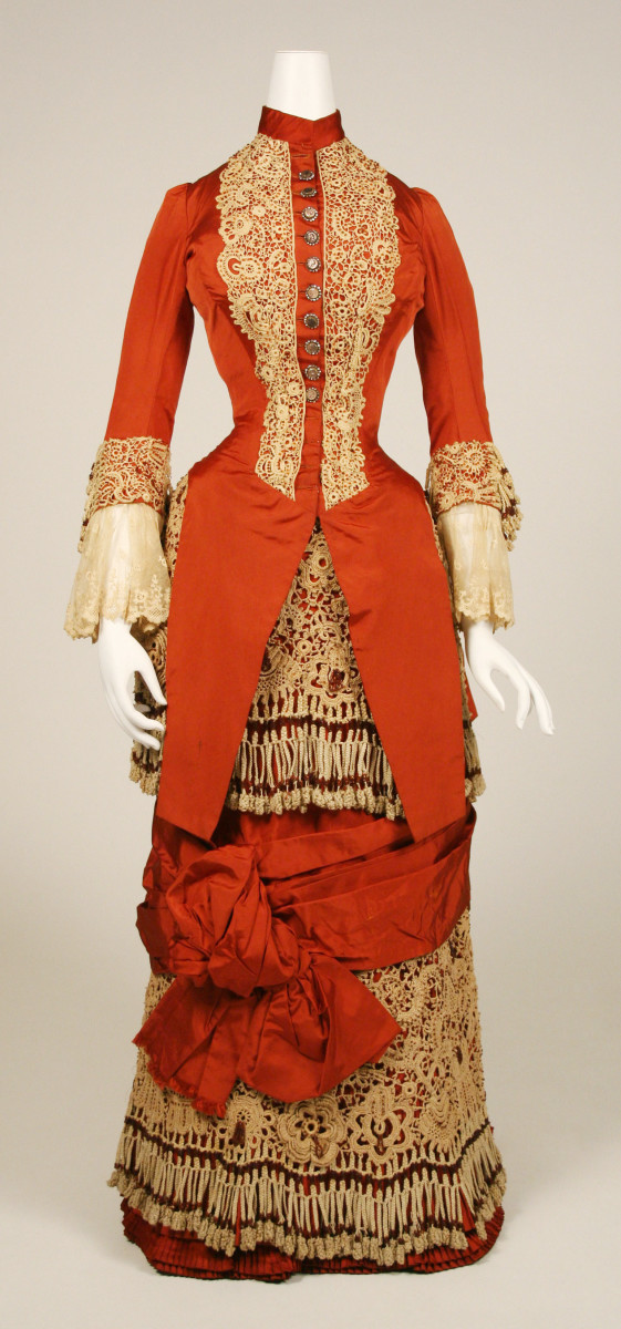 A silk and cotton dress with glass buttons, c. 1880, American.