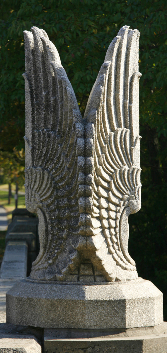 A close-up of the Art Deco wings on the James Farm Road Bridge.