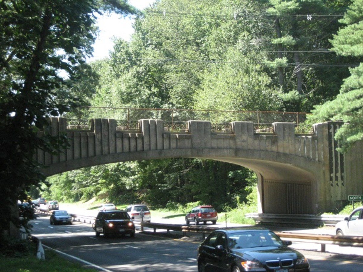 The North Avenue Bridge spans the Merritt Parkway in Westport. It's an Art Deco bridge featuring ferns, flowers, and a snail depicted in sgraffito panels at the top of the low protective wall.