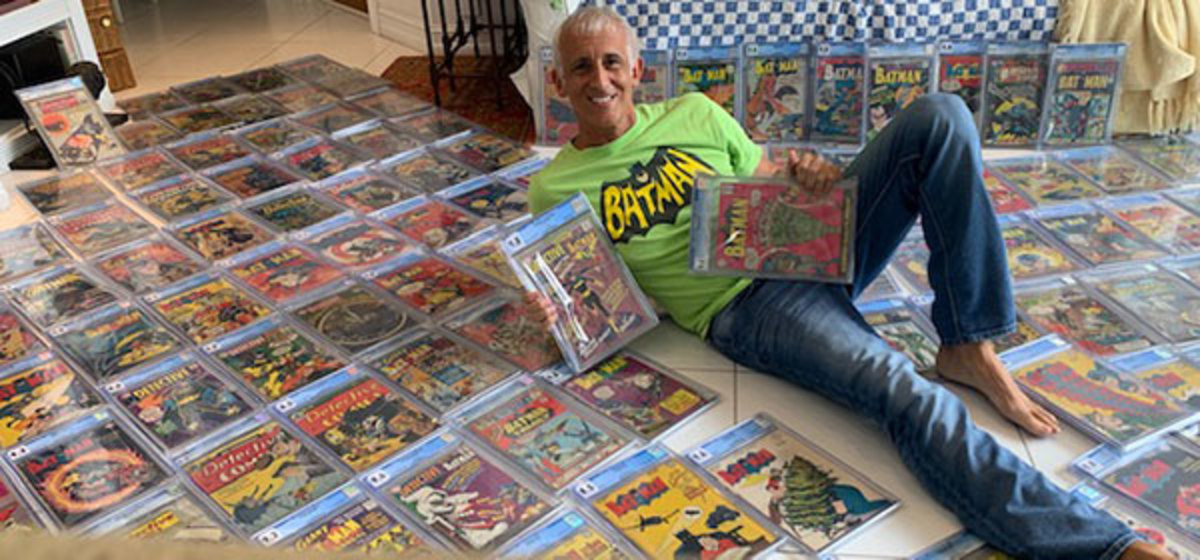 Randy Lawrence with his Batman comic book collection.