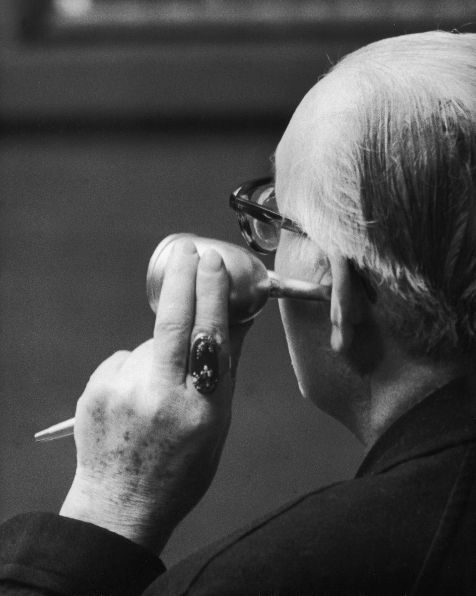 A potential buyer uses a swan-shaped ear trumpet at an auction at Sotheby's in 1974.