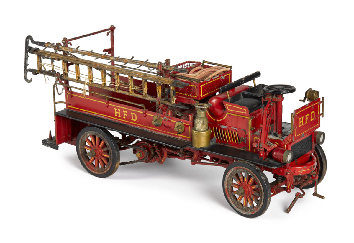 Pressed steel is also a must in a well-rounded toy auction and more than twenty vehicles will be offered including this fire truck.