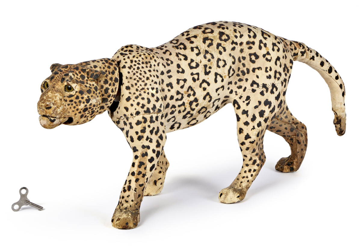 """A striding leopard measuring a fearsome 26"""" long has a key-wind and nodding head action."""
