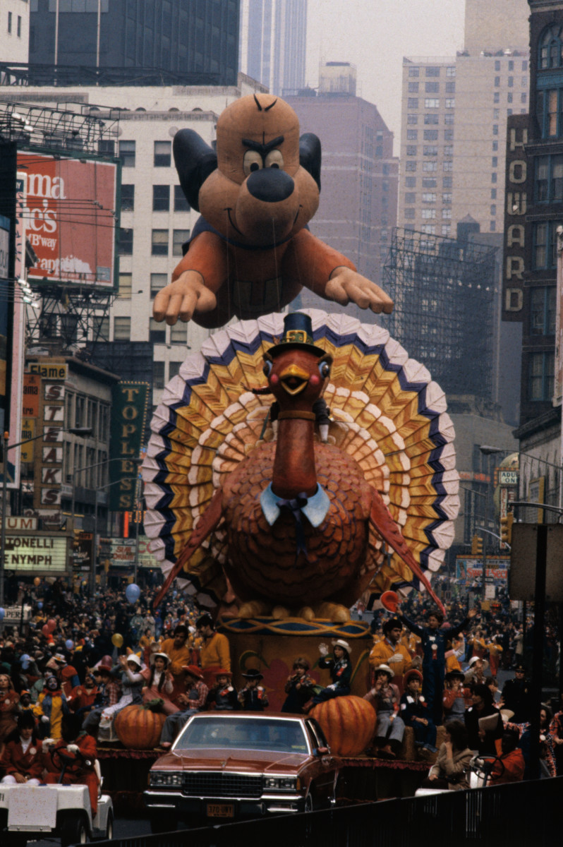 A 63-foot helium balloon of Underdog, a television cartoon favorite for millions of kids, follows a turkey float down Broadway in 1979. Maybe it's just us, but he seems to be looking at that turkey a bit nefariously.