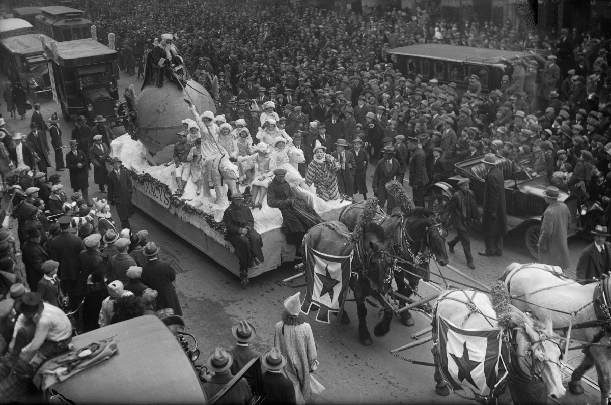 Santa Claus rides a parade float pulled by a team of horses down Broadway Street during the annual Macy's Thanksgiving Day Parade in New York City in 1925.