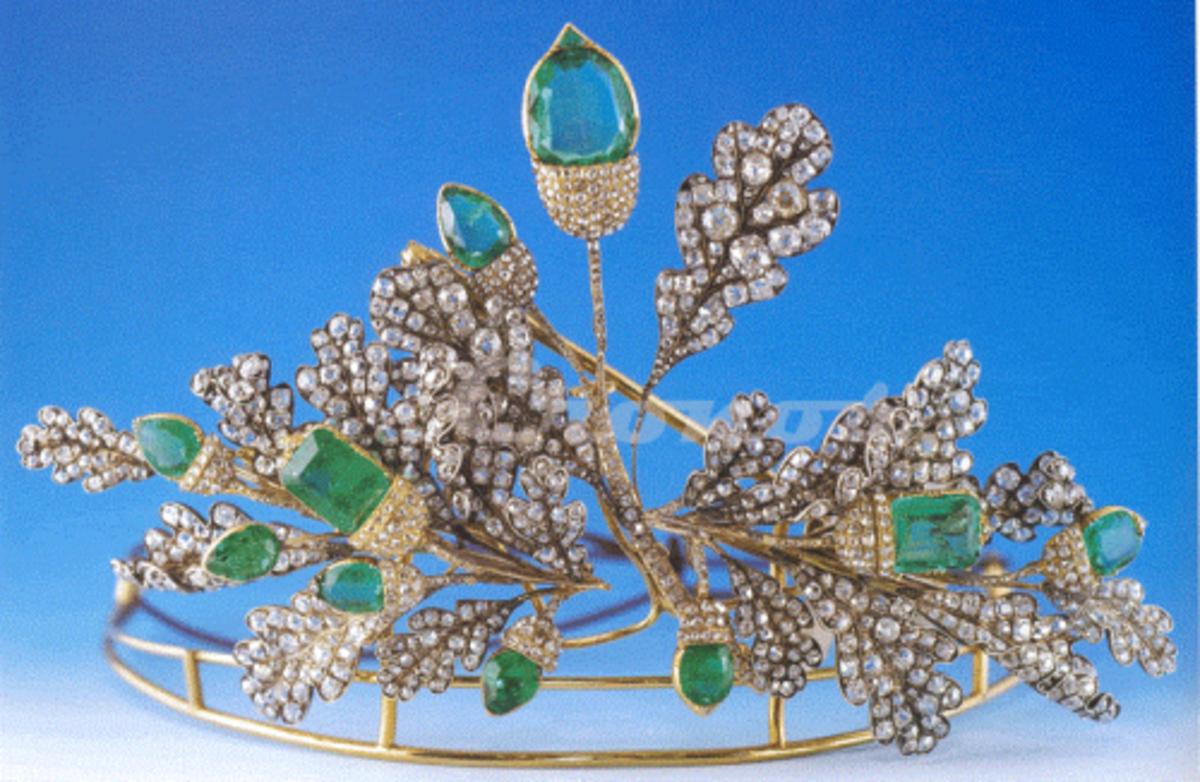 An oak-leaf tiara with emerald acorns.