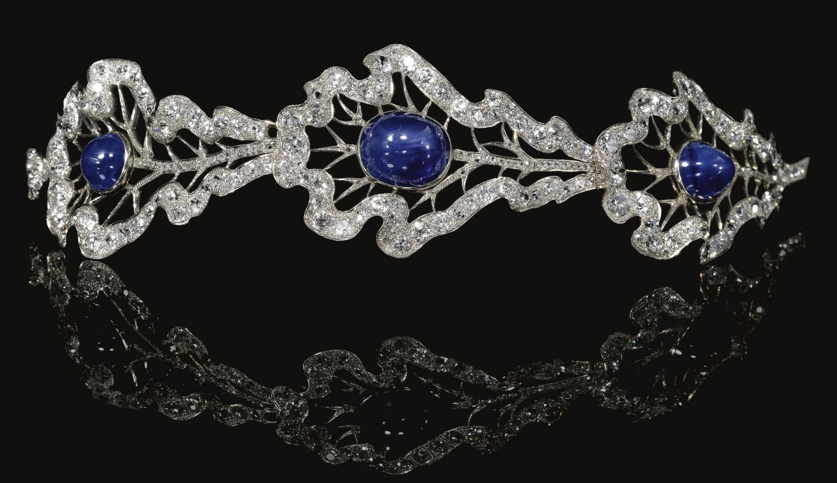 Sapphire and diamond bandeau, early 1930s, Thurn und Taxis. Set with three articulated oak leaves, each accented with a cabochon sapphire, and with a central star sapphire embellished with rose, circular-cut and cushion-shaped diamonds; $284,380.