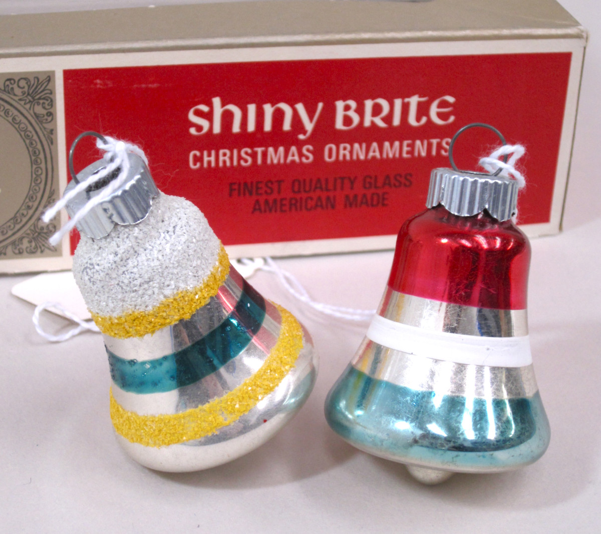Bell-shaped Shiny Brite glass ornaments, machine made, enameled and silvered; Max Eckardt & Sons and Corning Glass Works.