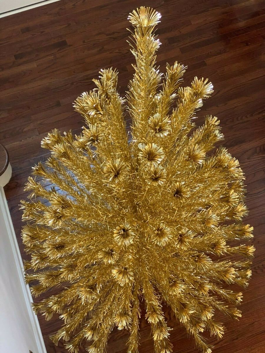 A vintage pom-pom tree in a rare gold color, 6-1/2-feet high with 151 branches; $4,050.