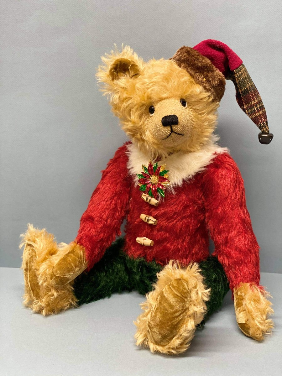 Jerry Abraham has more than 300 teddy bears in his collection, including this designer Kringle bear. He takes some of them with him when he travels around the world.