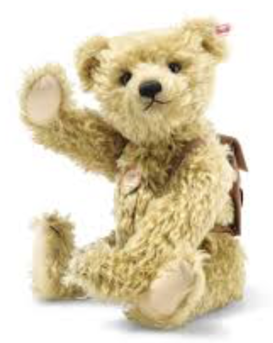 A contemporary mohair teddy bear wearing a backpack that's probably full of hugs.