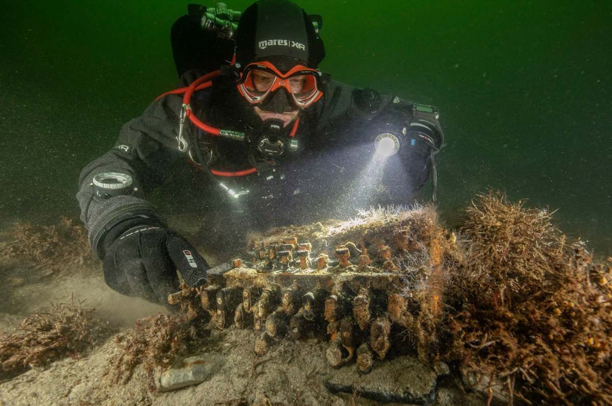 Research diver Florian Huber discovers the Enigma machine at the bottom of the Baltic Sea.