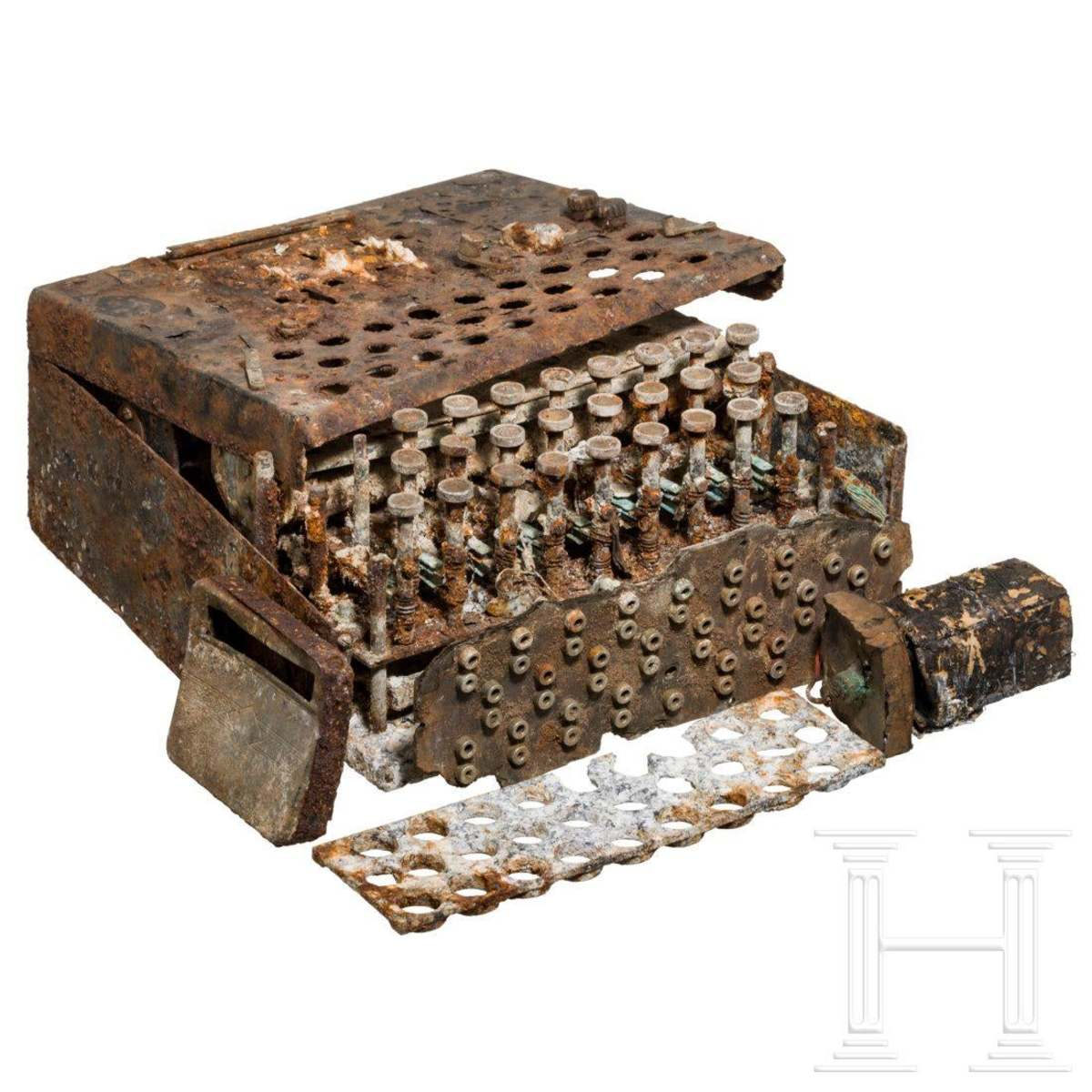 "An almost completely corroded ""Enigma I"" cipher machine, with three rotors for army and air force, used during the late 1930s and during the war; sold at auction for $50,750."
