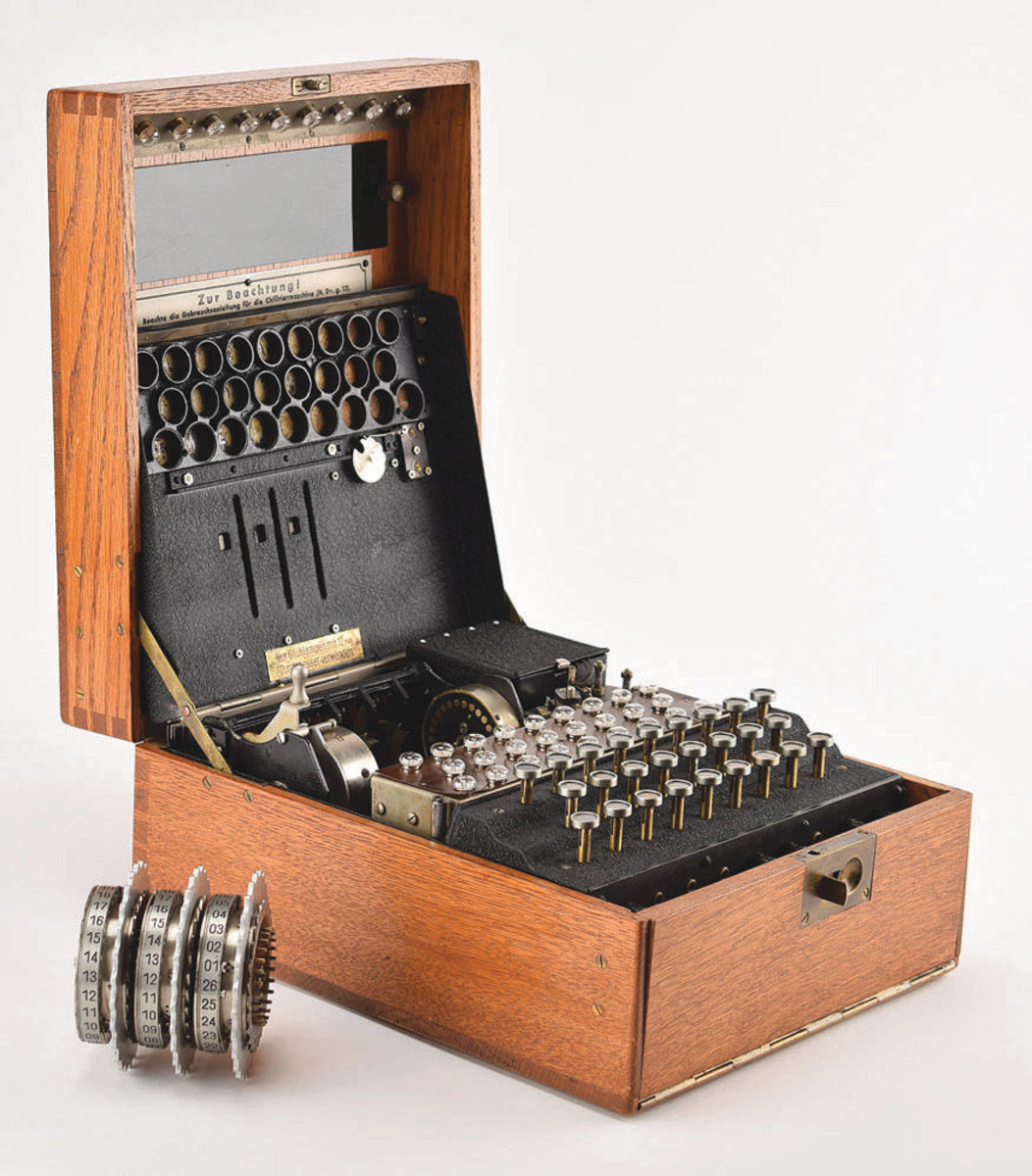 Enigma I electromechanical cipher machine, 1935, featuring an ebonite Steckerbrett (plugboard) on the front, which was exclusive to the German armed forces and exponentially increased the complexity of the code. This version of the Enigma is sometimes referred to as the Heeres (Army) Enigma, Wehrmacht Enigma, or Luftwaffe Enigma due to its military-specific application. This particular example boasts rare characteristics found only on early production machines: metal extra Stecker cable holders in the lid, rotors with all-metal construction, and original metal badges and tags. It sold at RR Auction for $338,630.