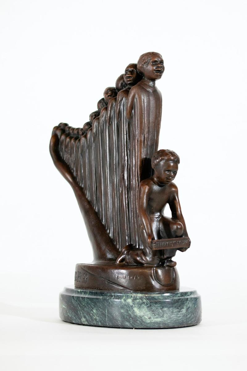 """The Harp (Lift Every Voice And Sing),"" metal with brown patina on a green marble base, 10-3/4"" x 9-1/2"" x 4""; sold in 2020 at Black Art Auction for $11,250."