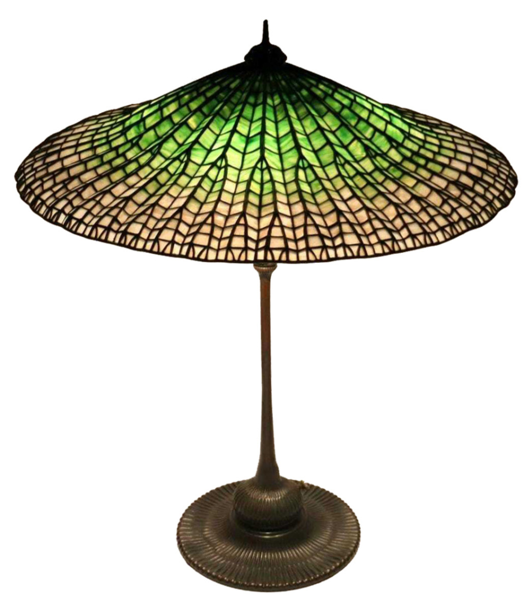 "Tiffany Studios' table lamp with ""Lotus"" shade. Sold by Clarke Auction through LiveAuctioneers for $150,000."
