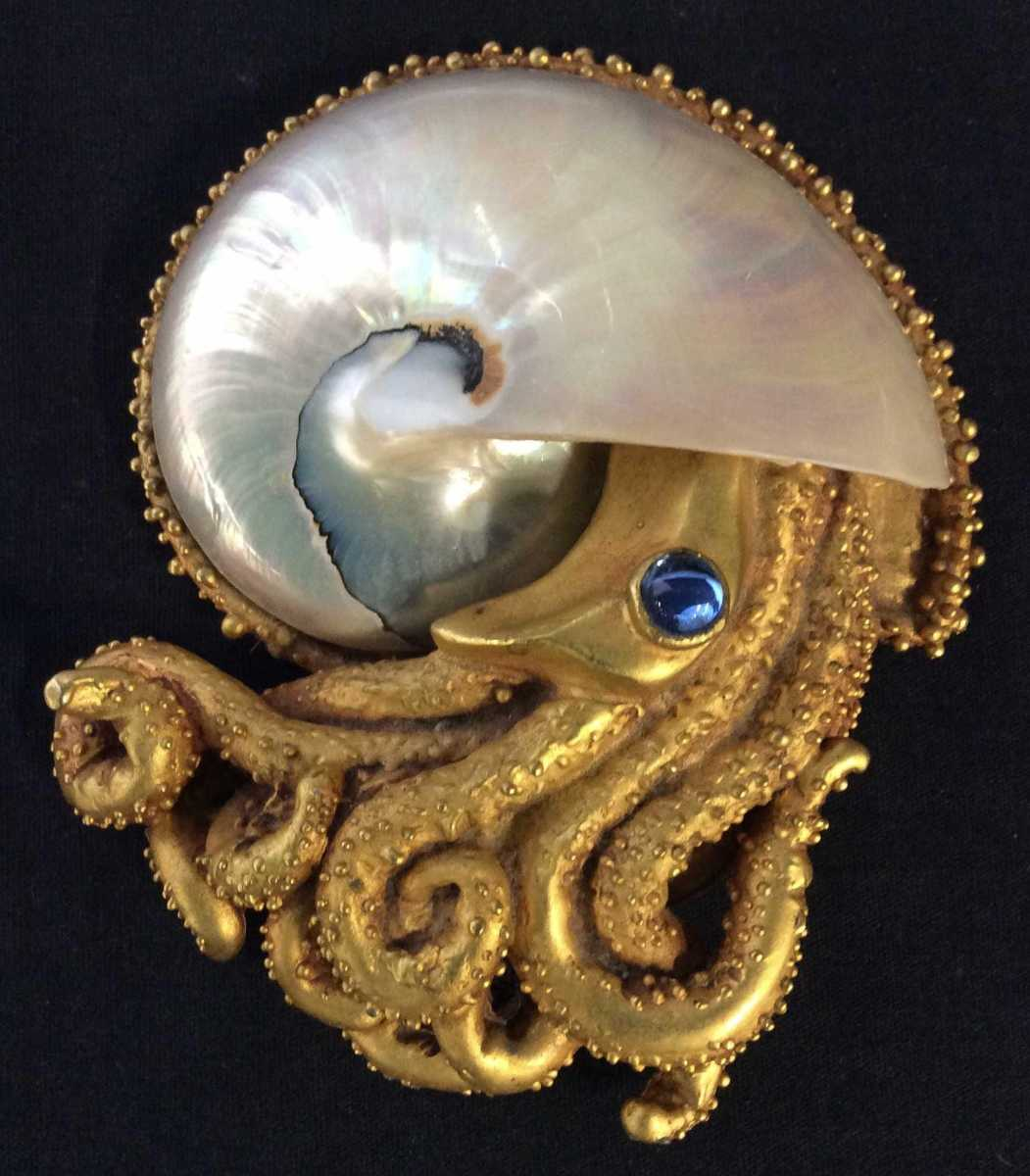 "A gold leaf and shell octopus figural tabletop with blue glass eye, signed Lazaro, 6"" x 4-1/2"". Sold by The Benefit Shop Foundation Inc. through LiveAuctioneers for $600."