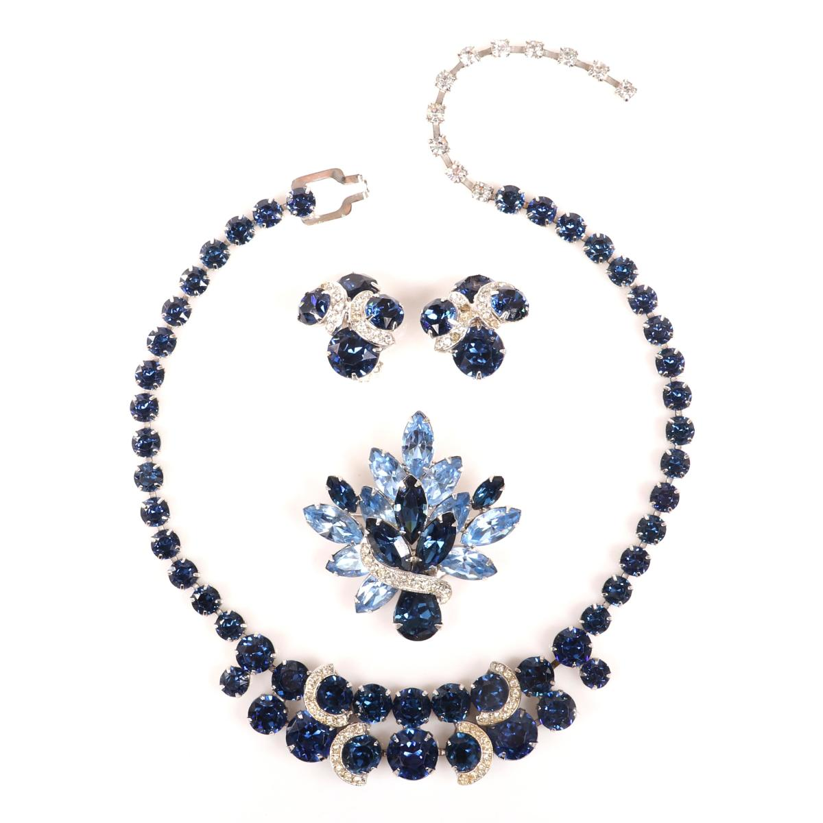 Costume jewelry came in at No. 3 with ages 20-40. Eisenberg sapphire crystal and pave group with matching necklace, earrings with semicircular rhinestone accents and layered brooch with marquise stones, c. 1950s; $225.