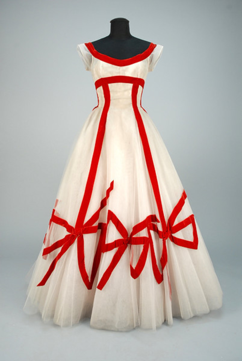 Ann Lowe one-of-a-kind ballgown, 1950s. White tulle with appliqued red velvet trim and oversized bows, fitted cap sleeve bodice and voluminous layered skirt, interior corset and stiff under-skirt. It sold at Whitaker Auctions for $1,600, far surpassing the estimate of $300-$500.