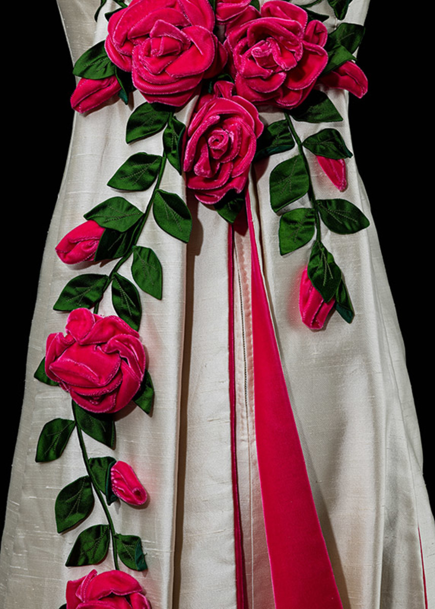 Roses in the back of the dress at full bloom.