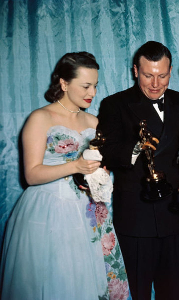 Olivia De Haviland, with Harold Russell, in the dress Ann Lowe designed, but did not get credit for.