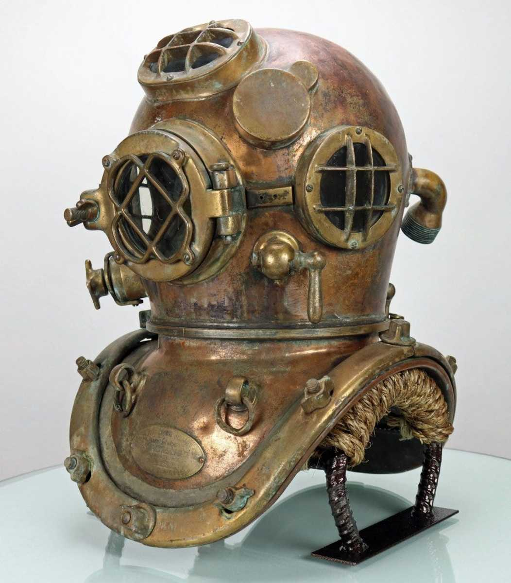 U.S. Navy Mark V diving helmet made by Diving Equipment & Salvage Company (DESCO) on D-Day, June 6, 1944. Just like an old penny, the helmet's copper has a warm patina with visual hints of hard work this helmet was part of over the years.
