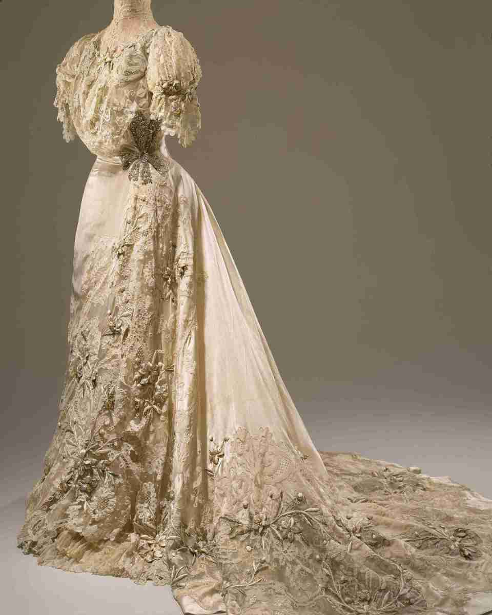 """When Post wed Edward Close on Dec. 5, 1905, she wanted """"the most glamorous wedding gown you could think of,"""" and this Hitchins & Balcom Edwardian wedding gown features lace, silver tissue, rhinestones, faux pearls, wired lilies, and cotton floss."""