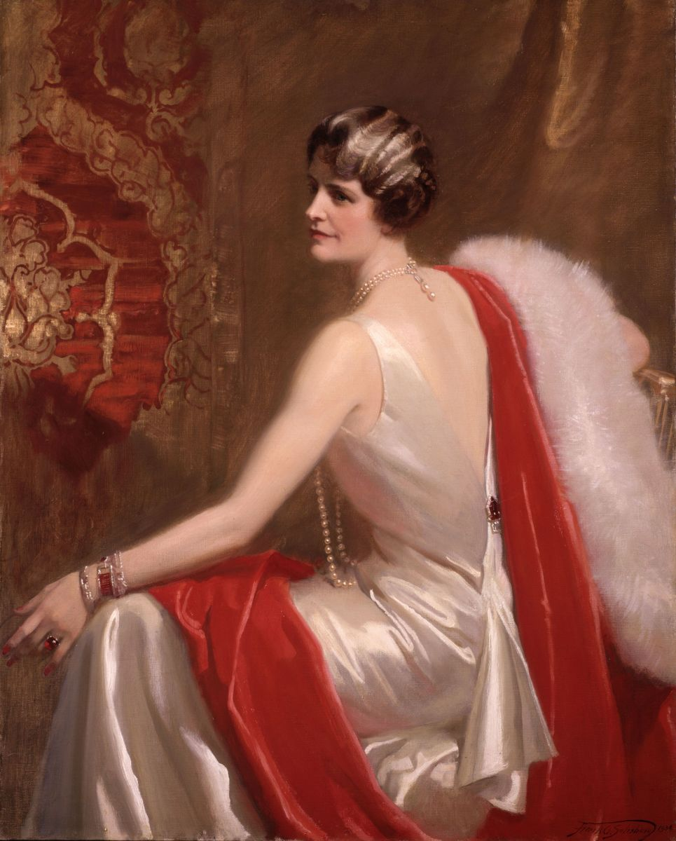 Post wore the dress in this portrait painted by Frank O. Salisbury (1874-1962) New York City, 1934. She accessorized it with pearls and red jewels.