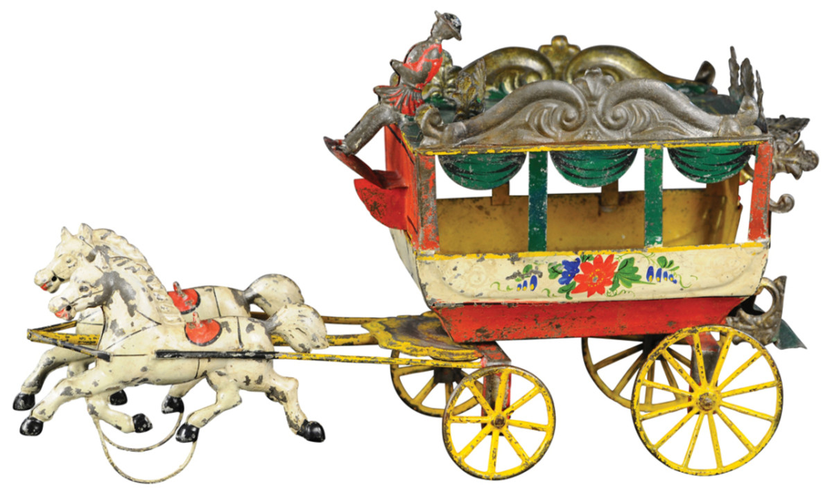 A pressed tin Francis Field and Francis Omnibus toy, mid-1800s, $11,000. An elusive find, this is one of only a handful known and among the best and brightest examples. The roof line of carriage has ornate filigree designs, simulated curtains hang in the large window cutouts, and the rear of carriage also has an elaborately decorated door cutout and stairwell. An original seated coachmen is at the reins, driven by a team of two original painted horses.