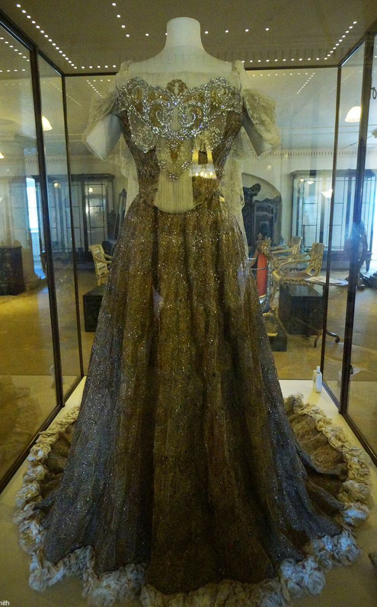 The original peacock dress is carefully preserved in a glass case at the Curzon family home in England.