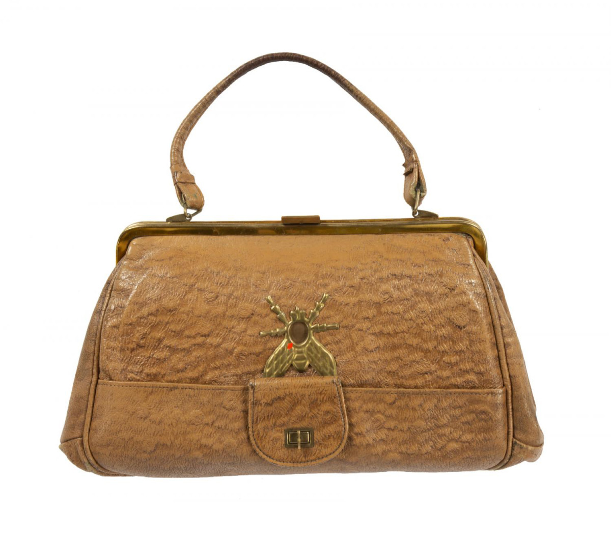 "A Soviet KGB spy purse from the 1950s used by female operatives and designed to hold a concealed FED model camera. The fly emblem on the front of the purse opens up to allow the camera to capture an image. The purse, which is lined with Vataline material to conceal sound, has come to be known as ""The Fly."" It was the top lot at Julien's and sold for $32,000."